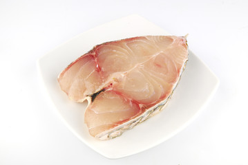 Fresh uncooked red fish meat fillet on white background
