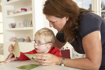 Downs Syndrome boyhaving speech therapy