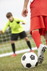 Boy goalkeeper braced for penalty shot