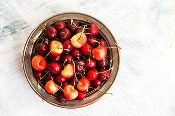 Cherries on rustic background