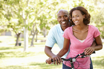 Young  couple cycling in park