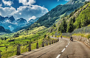 Fototapete - Group of bikers touring European Alps