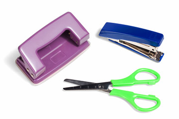Office stationery, stapler, puncher and scissors isolated on whi