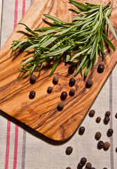 rosemary, pepper and allspice on rustic wooden table