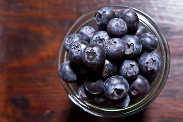 bowl of blueberries on rustic wooden table