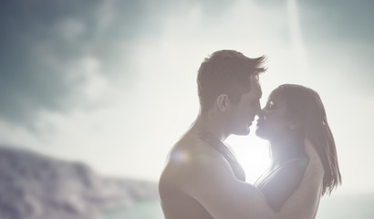 Romantic kiss backlit by the sun