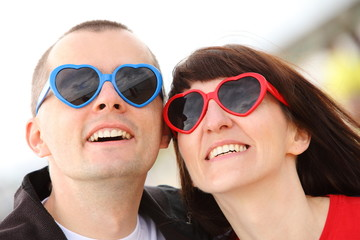 Woman and man with glasses shaped heart, summer time