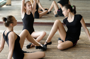 Three ballet dancers on the floor