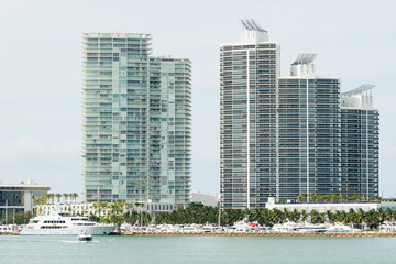 Wall Mural - Modern residencial buildings on Miami Beach with yachts docked n