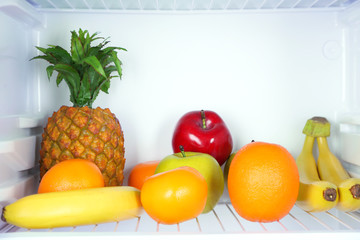 Fruits in open refrigerator. Weight loss diet concept.