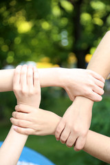 Hands in group on natural background