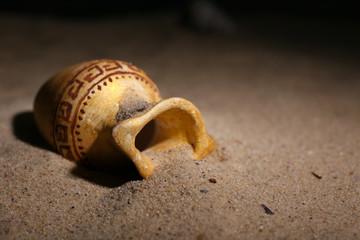 Fototapeta Greek ceramic amphora on sand, close up obraz