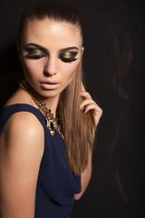 beautiful girl with smokey eyes makeup and bijou