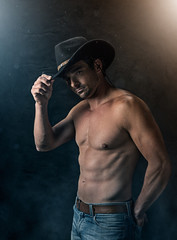 Sexy cowboy with smoky background