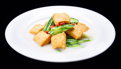 Luffa boiled tofu, Chinese traditional cuisine isolated on black