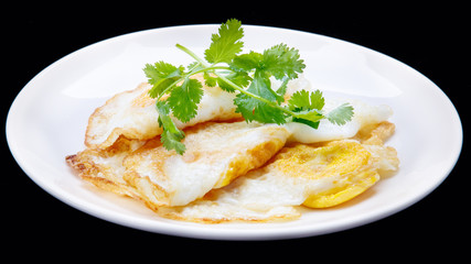 fried egg and  Parsley in the disc/isolation black background