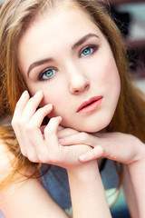 beautiful elegant young girl with blue eyes