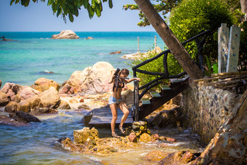 girl photographer is on the stone beach. Phangan