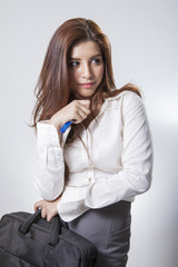 Beautiful brunette businesswoman holding handbag