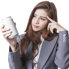 Young attractive businesswoman shop round a can of soft drink