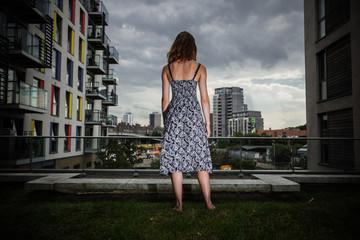 Young woman looking at city