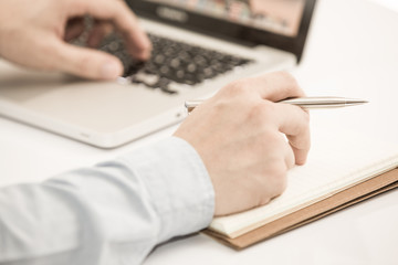 Close-up of Businessman using laptop