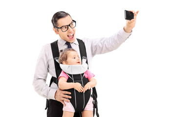 Young father taking selfie with his baby daughter