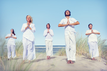 Group of People Doing Yoga on Beach