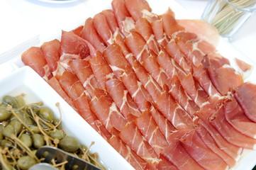 a plate with spanish serrano ham