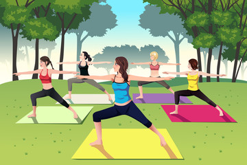 Group of women doing yoga in the park