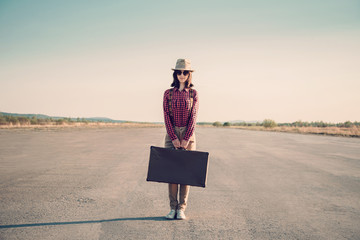 Hipster woman stands on road