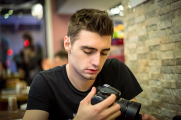 Young guy holding camera