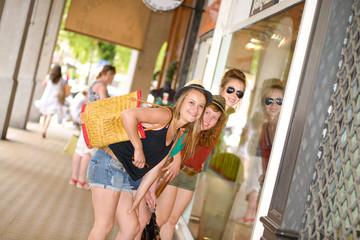 three young women go shopping