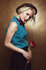 Vintage portrait of young beautiful blonde hipster girl with red