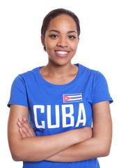 Standing woman from Cuba with crossed arms