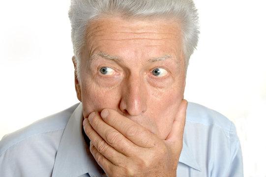 Senior shocked man
