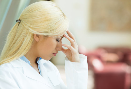 Side view closeup portrait sad stressed female doctor
