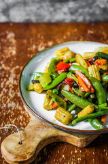 Baked vegetables on rustic background