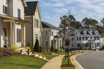 Row of upscale houses on a curved neighborhood street