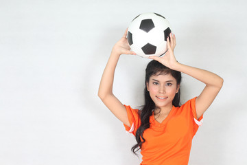Half Portrait Beautiful woman hold ball over her head with weari
