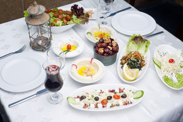 Arabic food of dates, hommos, cheese, labneh and fattoush