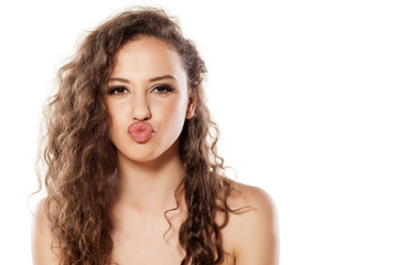 beautiful young girl with a kissing gesture