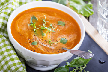 Tomato soup in white bowl