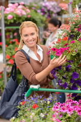 Woman shopping for colorful flowers garden center