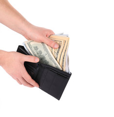 Hand holding wallet with dollar bills.