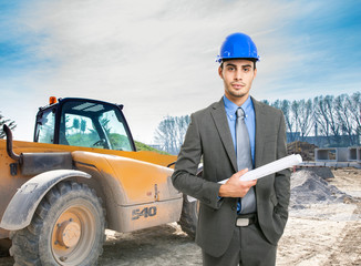Architect at work in a construction site