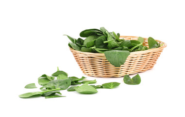 Bunch of spinach in a wicker basket.