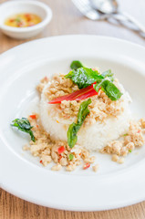 Spicy fried chicken with basil and rice