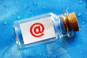 E-mail @ symbol message in a bottle
