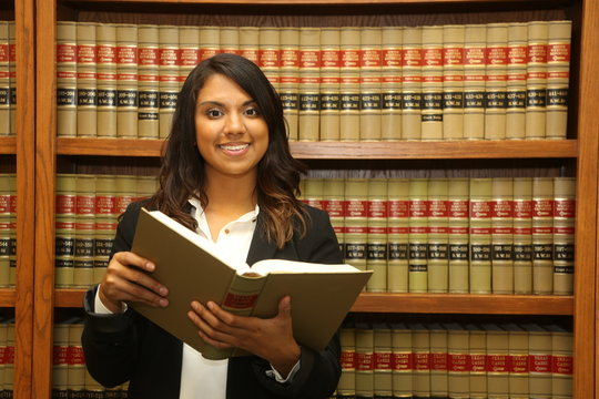 Female law student in law library